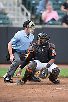 Aberdeen IronBirds catcher Jean Carrillo (51) checks the runner at first base as home plate umpire Chad Dixon looks on during the game against the Hudson Valley Renegades at Leidos Field at Ripken Stadium on July 27, 2017 in Aberdeen, Maryland.  The Renegades defeated the IronBirds 2-0 in game one of a double-header.  (Brian Westerholt/Four Seam Images)