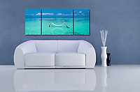 """This panoramic view shows the expanse of the aquamarine water of the Indian Ocean surrounding a hammock in a shallow lagoon. A mosaic arrangement of three prints displayed as a triptych (photograph is divided into three separate panels hung 1"""" apart)"""