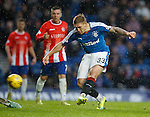 Martyn Waghorn scores his first and Rangers third goal of the match