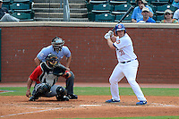 Chattanooga Lookouts first baseman J.T. Wise #31 at bat in front of catcher Miguel Gonzalez #33 and umpire Derek Mollica during a game against the Birmingham Barons on April 17, 2013 at AT&T Field in Chattanooga, Tennessee.  Chattanooga defeated Birmingham 5-4.  (Mike Janes/Four Seam Images)