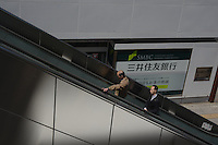 People are passing in front of Mitsui Sumitomo bank  in Tachikawa, Tokyo, Japan.