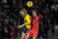 COLUMBUS, OH - NOVEMBER 07: Magdalena Eriksson #6 of Sweden and Carli Loyd #10 of the United States leap high in the air for a ball during a game between Sweden and USWNT at MAPFRE Stadium on November 07, 2019 in Columbus, Ohio.