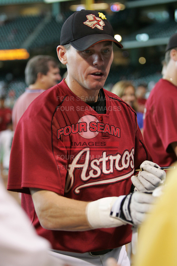 Houston Astros second baseman Craig Biggio (7) signs autographs before the Major League Baseball game against the Pittsburgh Pirates on August 13, 2005 at Minute Maid Park in Houston, Texas. The Pirates defeated the Astros 1-0. (Andrew Woolley/Four Seam Images)