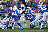 New York Jets running back Elijah McGuire (25) is tackled by Micah Hyde (23) and Lorenzo Alexander (57) during an NFL football game against the Buffalo Bills, Sunday, December 9, 2018, in Orchard Park, N.Y.  (Mike Janes Photography)
