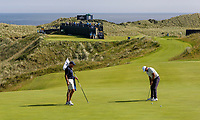 150719 | The 148th Open - Monday Practice<br /> <br /> Jason Day of Australia with caddie Steve Williams putts on the 16th green during practice for the 148th Open Championship at Royal Portrush Golf Club, County Antrim, Northern Ireland. Photo by John Dickson - DICKSONDIGITAL