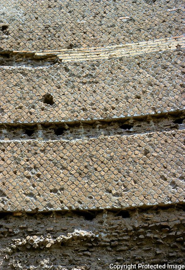 "Italy: Tivoli--Hadrian's Villa, detail of Pecile Wall* . Grooves produced by removal of bricks for Villa O'Este.  *Note: ""opus reticulatum"" --small tufa blocks arranged diagonally. Photo '83."