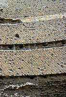 "Italy: Tivoli--Hadrian's Villa, detail of Pecile Wall* . Grooves produced by removal of bricks for Villa O'Este.  *Note: ""opus reticulatum"" --small tufa blocks arranged diagonally. Photo '83."