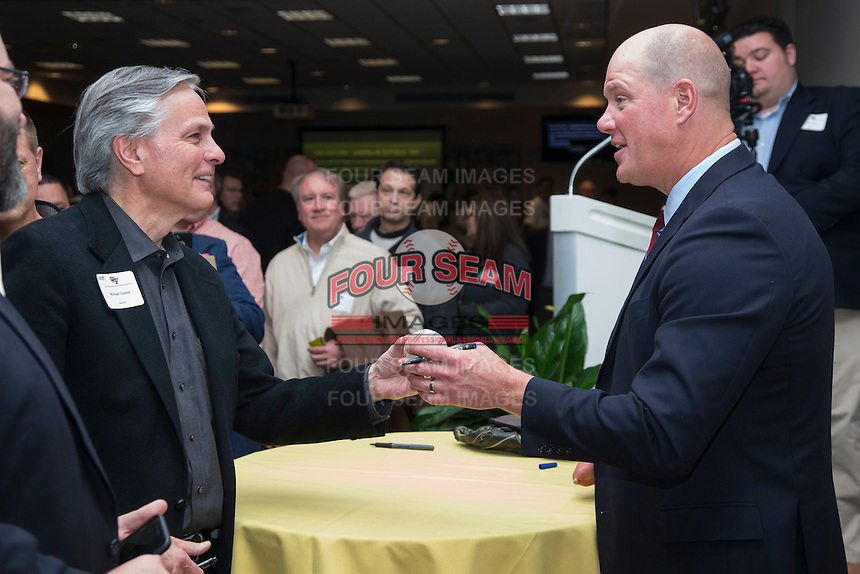 """Michael Coates (left) has a baseball autographed by guest speaker and former Major League Baseball pitcher Jim Abbott at the Wake Forest Baseball """"First Pitch"""" Dinner on February 9, 2017 in Winston-Salem, North Carolina.  (Brian Westerholt/Four Seam Images)"""