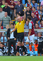 Saturday 15 September 2012<br /> Pictured: Matthew Lowton of Aston Villa (R) is shown a yellow card by match referee L Mason (L).<br /> Re: Barclay's Premier League, Aston Villa v Swansea City FC at Villa Park, West Midlands, UK.