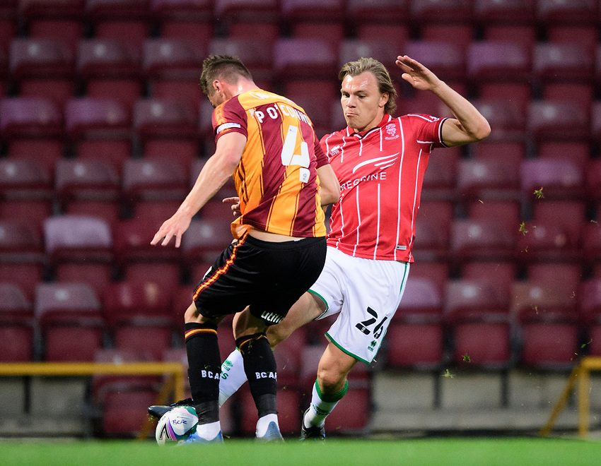 Lincoln City's Harry Anderson vies for possession with Bradford City's Paudie O'Connor<br /> <br /> Photographer Chris Vaughan/CameraSport<br /> <br /> Carabao Cup Second Round Northern Section - Bradford City v Lincoln City - Tuesday 15th September 2020 - Valley Parade - Bradford<br />  <br /> World Copyright © 2020 CameraSport. All rights reserved. 43 Linden Ave. Countesthorpe. Leicester. England. LE8 5PG - Tel: +44 (0) 116 277 4147 - admin@camerasport.com - www.camerasport.com