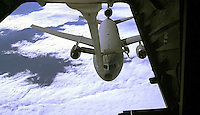 A KC-10 air tanker from the 60th Air Refueling Squadron at Travis Air Force base moves into position for air to air refueling from another KC-10 over Oregon Friday Oct. 5 2001. The KC-10 tankers can transfer up to 340,000 pounds of fuel on a mission. (Photo by Alan Greth)