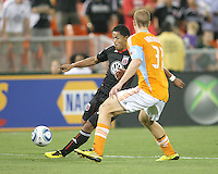 Andy Najar #14 of D.C. United crosses over past Andrew Hainault #31 of the Houston Dynamo during an MLS match at RFK Stadium in Washington D.C. on September  25 2010. Houston won 3-1.