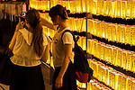 Visitors take a selfie with the lanterns during the annual ''Mitama Festival'' at Yasukuni Shrine on July, 13, 2015, Tokyo, Japan. Over 30,000 lanterns line the entrance to the shrine to help spirits find their way during the annual celebration for the spirits of ancestors. The festival is held from July 13th to 16th. (Photo by Rodrigo Reyes Marin/AFLO)