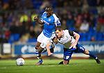 St Johnstone v Inverness Caley Thistle..29.12.12      SPL.Gregory Tade fends off Gary Warren.Picture by Graeme Hart..Copyright Perthshire Picture Agency.Tel: 01738 623350  Mobile: 07990 594431