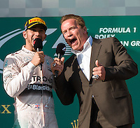 "March 15, 2015: Arnold Schwarzenegger and Lewis Hamilton (GBR) #44 (1st) says his ""I'll be back"" on the podium at the 2015 Australian Formula One Grand Prix at Albert Park, Melbourne, Australia. Photo Sydney Low"