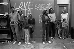 """Black British teenagers 1980s Notting Hill Carnival London. Mixed race child with white mother black British father hanging out around Reggae Sound System England 1981 Sons of Thunder, refers to the Christian rock band named for two of Jesus' disciples James and John, to whom Jesus gave the name """"Boanerges"""" which is Sons of Thunder. The group was formed in 1967"""