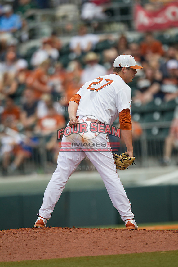 Texas Longhorns pitcher Travis Duke #27 looks to his catcher for the sign during the NCAA baseball game against the Oklahoma State Cowboys on April 26, 2014 at UFCU Disch–Falk Field in Austin, Texas. The Cowboys defeated the Longhorns 2-1. (Andrew Woolley/Four Seam Images)