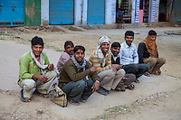 Bharatpur, Rajasthan, India.  Young Men Sitting Together at the end of the Day.