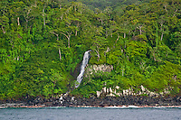 Waterfall plunging from the jungle into the Pacific Ocean at Cocos Island National Park, Costa Rica.