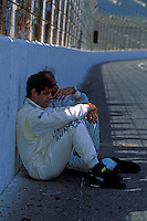 "Domenico ""Mimmo"" Schiattarella (front) and Emanuele Pirro sit in the shade of the front straight wall before the start."