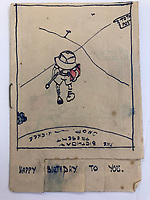 BNPS.co.uk (01202) 558833<br /> Pic: Tennants/BNPS<br /> <br /> Captain Harry Witheford's birthday sketch for his wife Edna<br /> <br /> Cartoon drawings and photographs documenting life in a brutal Japanese prisoner of war camp have been found in an archive belonging to a former soldier. <br /> <br /> The satirical sketches depicting the plight of the British PoWs were produced in secret by Captain Harry Witheford and fell inmate Ronald Searle, the famous illustrator. <br /> <br /> The scenes included the notorious Changi PoW camp in Singapore and the building of the 'Death Railway' along the River Kwai in Burma. <br /> <br /> There are three previously unseen cartoons by Searle. <br /> <br /> One is a sketch to mark Capt Witheford's wife Edna's birthday on April 10, 1944, which shows four officers wearing only loincloths toasting her with mugs of beer.<br /> <br /> Searle also created a calendar for his friend which depicted an image of an army officer lying besides a naked blonde woman. <br /> <br /> Capt Witheford's accomplished work includes a drawing of a prisoner having a bath covered in sunburns from working on the railway.