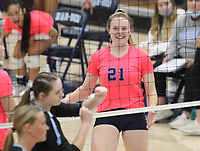 Kyla Club (21) smiles after kill against Southside on Tuesday, October 12, 2021, during play at Wildcat Arena, Springdale. Visit nwaonline.com/211013Daily/ for today's photo gallery.<br /> (Special to the NWA Democrat-Gazette/David Beach)