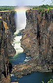 Victoria Falls, Zambia to Zimbabwe border. The Falls through the canyon with rainbow colours.