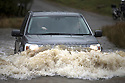28/03/16 <br /> <br /> A 4x4 is tested to the limit as it crosses a flooded river crossing near Tissington in the Derbyshire Peak district.<br /> <br /> All Rights Reserved: F Stop Press Ltd. +44(0)1335 418365   +44 (0)7765 242650 www.fstoppress.com
