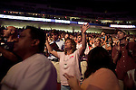 """Sunday, June 24, Raleigh, North Carolina.. California evangelist Greg Laurie, brought his """"Harvest Crusade"""" to the RBC Center in Raleigh, NC for 3 days of music. prayer and Christian evangelism. Laurie brought together 200 local churches to sponsor the event which used 3000 volunteers and hopes to convert many newcomers to his version of born again Christianity.. Believers danced and prayed to the hour and a half long music program that preceded Laurie's sermon."""