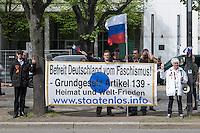 """Die rechte Gruppierung """"Reichsbuerger - Die Staatenlosen"""" demonstriert vor der Russischen Botschaft in Berlin ihre Solidaritaet mit Russland ind er Ukraine-Krise.<br /> Aus Solidaritaet mit Russland und den Russewn in der Ukraine haben die Reichsbuerger das tragen von orange-schwarzen Schleifen eingefuehrt. Dieses Symbol ist in der Ukraine verboten. Mittlerweile tragen auch Linke diese Schleife.<br /> 17.4.2014, Berlin<br /> Copyright: Christian-Ditsch.de<br /> [Inhaltsveraendernde Manipulation des Fotos nur nach ausdruecklicher Genehmigung des Fotografen. Vereinbarungen ueber Abtretung von Persoenlichkeitsrechten/Model Release der abgebildeten Person/Personen liegen nicht vor. NO MODEL RELEASE! Don't publish without copyright Christian-Ditsch.de, Veroeffentlichung nur mit Fotografennennung, sowie gegen Honorar, MwSt. und Beleg. Konto:, I N G - D i B a, IBAN DE58500105175400192269, BIC INGDDEFFXXX, Kontakt: post@christian-ditsch.de<br /> Urhebervermerk wird gemaess Paragraph 13 UHG verlangt.]"""
