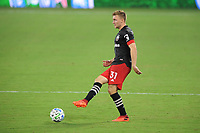 WASHINGTON, DC - AUGUST 25: Julian Gressel #31 of D.C. United moves the ball during a game between New England Revolution and D.C. United at Audi Field on August 25, 2020 in Washington, DC.