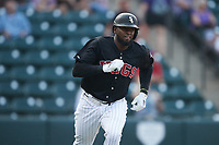 Luis Robert (19) of the Winston-Salem Warthogs hustles down the first base line against the Jersey Shore BlueClaws at Truist Stadium on July 21, 2021 in Winston-Salem, North Carolina. (Brian Westerholt/Four Seam Images)