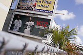 "Miami-Dade County, Florida.USA.November 2, 2004..A P. Diddy shirt/poster  ""Vote or Die"" in a black area of Miami-Dade..."