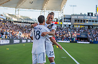 CARSON, CA - SEPTEMBER 29: Uriel Antuna #18 and Rolf Feltscher #25 of the Los Angeles Galaxy celebrate Uriel's goal during a game between Vancouver Whitecaps and Los Angeles Galaxy at Dignity Health Sports Park on September 29, 2019 in Carson, California.