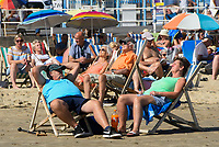 BNPS.co.uk (01202 558833)<br /> Pic: Graham Hunt/BNPS<br /> Date: 7th September 2021.<br /> <br /> Sunbathers flock to the beach to enjoy the scorching hot sunshine at the seaside resort of Weymouth in Dorset.<br /> <br /> Sunbathers basking in the hot sunshine at the beach.