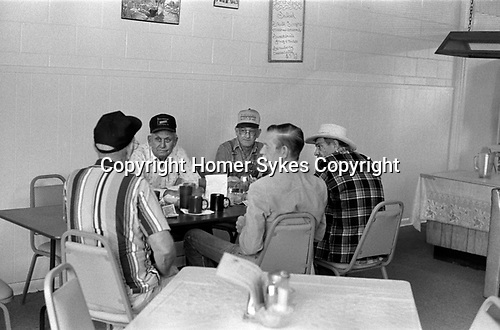 Group of blue collar working men holding a meeting in a diner, resturant Sweetwater, Nolan County, Texas, 1999 1990s USA