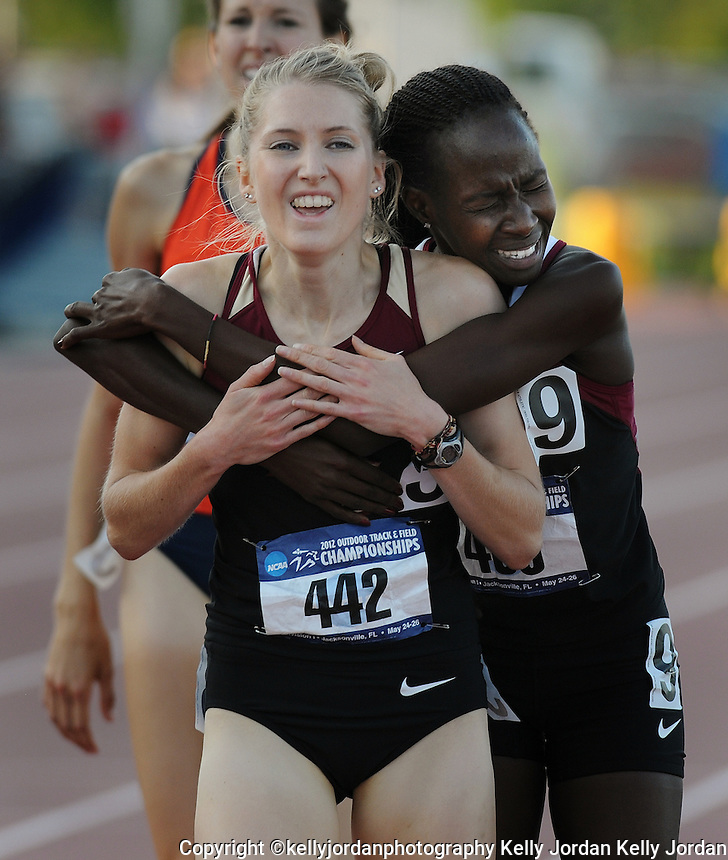 Kelly.Jordan@jacksonville.com--052612--Hannah Brooks, left, of Florida State University gets a big hug from her teammate Violah Lagat after Brooks won the womens 1500 meter run during the NCAA Division 1 2012 Outdoor Track & Field Championships-East Preliminary at the University of North Florida in Jacksonville, Florida Saturday May 26, 2012. Three FSU teammates, Hannah Brooks, Amanda Winslow and Violah Lagat would finish first, third and fourth in the race qualifying them for the finals.(The Florida Times-Union, Kelly Jordan)
