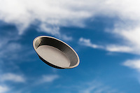 On Pi(e) Day, 3-14, a pie pan floats against a blue sky with high clouds.