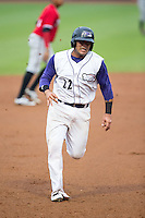 Omar Narvaez (22) of the Winston-Salem Dash hustles towards third base against the Carolina Mudcats at BB&T Ballpark on July 23, 2015 in Winston-Salem, North Carolina.  The Dash defeated the Mudcats 3-2.  (Brian Westerholt/Four Seam Images)