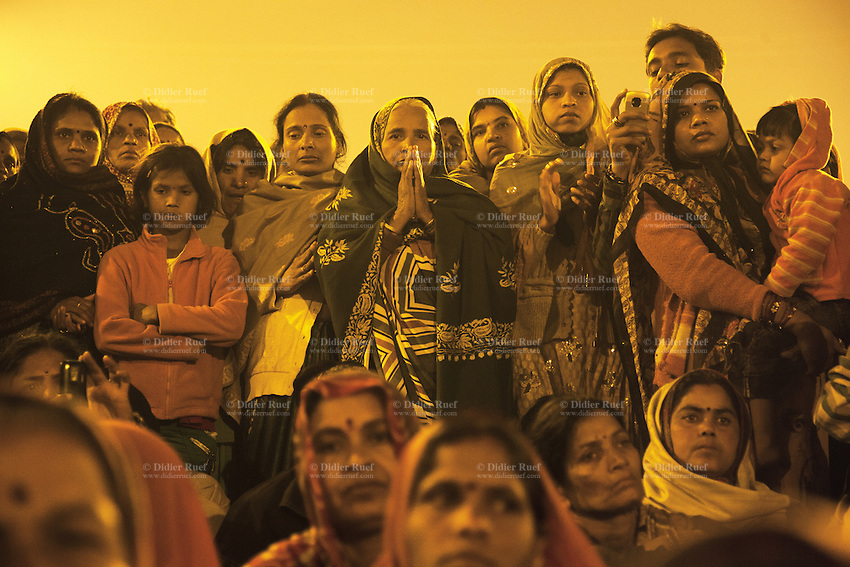 India. Uttar Pradesh state. Allahabad. Maha Kumbh Mela. A woman prays at night during a Ganga Aarti ceremony. Ganga Aarti (also spelled arathi, aarthi) is a Hindu religious ritual of worship, a part of puja, in which light from wicks soaked in ghee (purified butter) or camphor is offered to one or more deities. The Kumbh Mela, believed to be the largest religious gathering is held every 12 years on the banks of the 'Sangam'- the confluence of the holy rivers Ganga, Yamuna and the mythical Saraswati. The Maha (great) Kumbh Mela, which comes after 12 Purna Kumbh Mela, or 144 years, is always held at Allahabad. Uttar Pradesh (abbreviated U.P.) is a state located in northern India. 11.02.13 © 2013 Didier Ruef