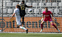 LOS ANGELES, CA - APRIL 17: Tomás Pochettino #7 of Austin FC battles with Diego Palacios #12 of LAFC during a game between Austin FC and Los Angeles FC at Banc of California Stadium on April 17, 2021 in Los Angeles, California.