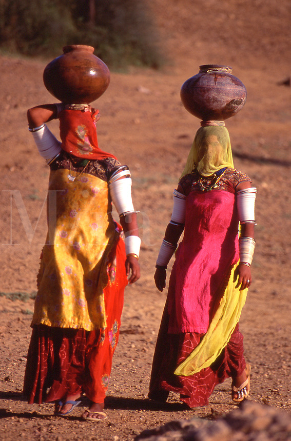 India Women fetching water in the desert of Thar