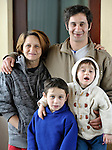 A Roma family displaced by severe cold and snow poses for a photo in the Red Cross shelter in Smederevo, Serbia. Church World Service has provided food for this and other affected families. They are Nedja Ajdarevic (left) and her husband Canija Ramadanovic, and their son Demka and daughter Ferdjarn.