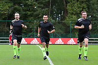Assistant referee Olivier Jacques, referee Mehdi Sayoud and assistant referee Romain Deltree warming up before a female soccer game between Standard Femina de Liege and White Star Woluwe on the fifth matchday of the 2021 - 2022 season of Belgian Scooore Womens Super League , saturday 2 nd of October 2021  in Angleur , Belgium . PHOTO SPORTPIX   SEVIL OKTEM