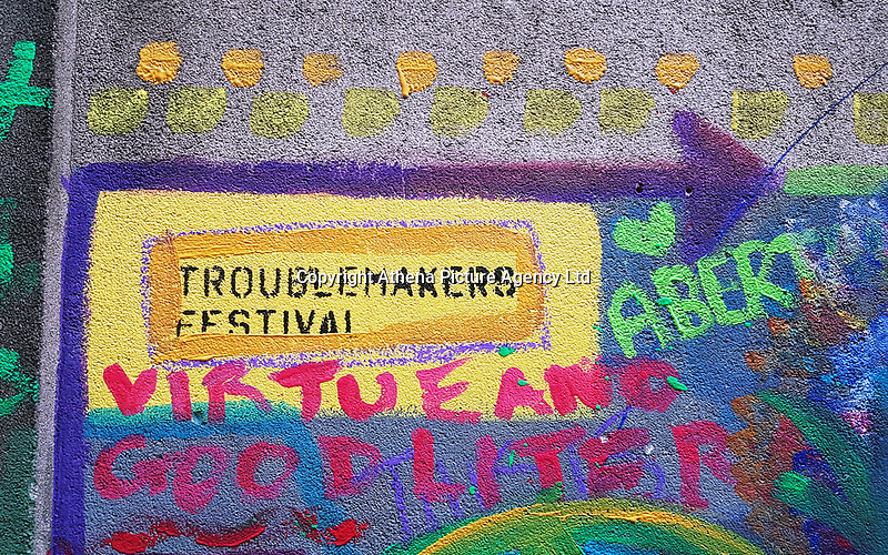 Pictured: Graffitis on the side wall of The Volcano Theatre, High Street, Swansea. Saturday 15 July 2017<br />Re: The Troublemakers Festival, on the High Street, Swansea, south Wales, UK.
