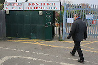 A spectator arrives at the ground and enters through the main turnstile block - AFC Hornchurch vs Wingate & Finchley - Ryman League Premier Division Football at Hornchurch Stadium, Bridge Avenue, Upminster, Essex - 30/11/13 - MANDATORY CREDIT: Gavin Ellis/TGSPHOTO - Self billing applies where appropriate - 0845 094 6026 - contact@tgsphoto.co.uk - NO UNPAID USE
