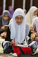 Muslim Women Waiting to Begin Quranic Study Class with their Imam, Ubudiah Mosque, Kuala Kangsar, Malaysia.