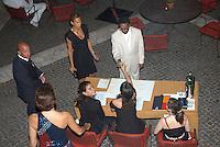 TONYA LEWIS LEE & SPIKE LEE .The Film Award Sesterzio Silver 2008 held at the Jardin de Russie,.Rome 24th June 2008..half length cream white pinstripe suit table black dress .CAP/CAV.©Luca Cavallari/Capital Pictures