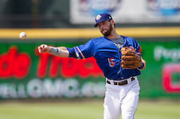 Round Rock Express second baseman Jason Donald (5) makes a throw to first base during the first game of a Pacific Coast League doubleheader against the Memphis Redbirds on August 3, 2014 at the Dell Diamond in Round Rock, Texas. The Redbirds defeated the Express 4-0. (Andrew Woolley/Four Seam Images)
