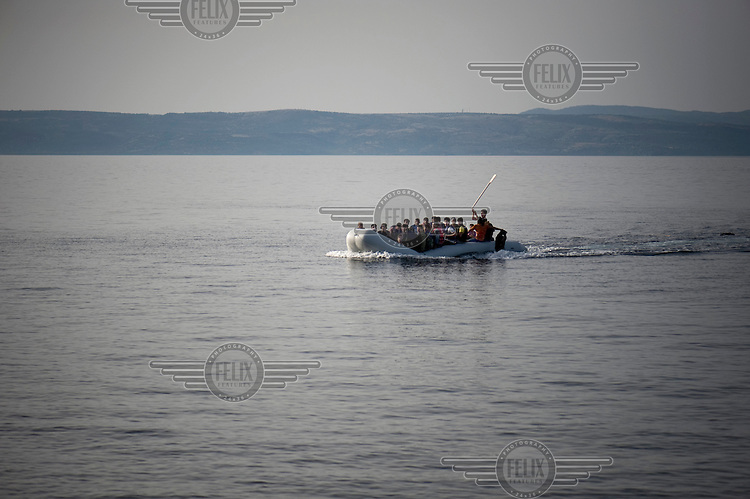 A small inflatable boat with more than 40 Afghan refugees is seen off the coast of the Greek island of Lesbos minutes before landing on the beach of Skala Sykaminias. The people on board are singing with joy before their arrival in Europe. Every day hundreds of refugees, mainly from Syria and Afghanistan, are crossing in small overcrowded inflatable boats the 6 mile channel from the Turkish coast to the island of Lesbos in Greece.